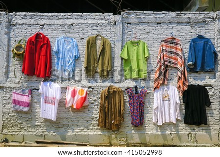 hanging clothes on the white brick wall