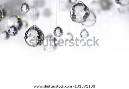 Hanging crystal balls, studio shot - stock photo