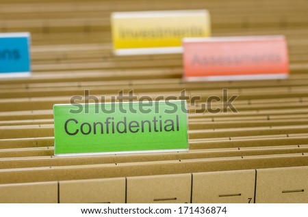 Hanging file folder labeled with Confidential - stock photo