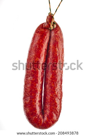 hanging Hungarian smoked sausage with paprika isolated on white background - stock photo
