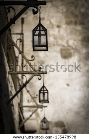 Hanging lanterns in a black and white filter - stock photo