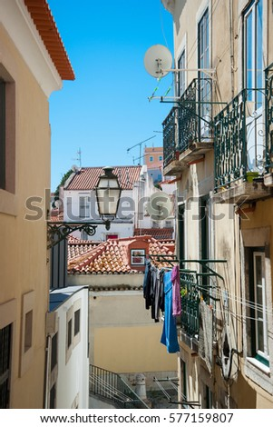 Hanging laundry in Portugal. Narrow street of Lisbon, low angle view