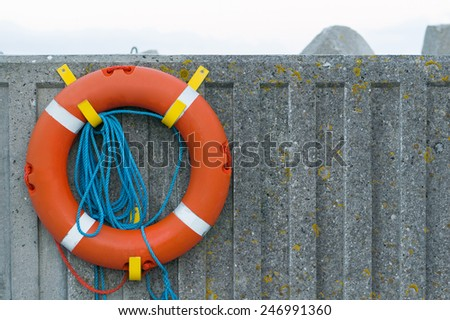 hanging life saver on the wall - stock photo