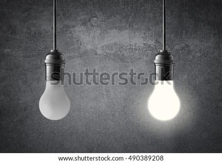 hanging light bulbs on grunge wall idea concept