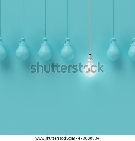 hanging light bulbs with glowing one different idea on light blue background minimal concept idea