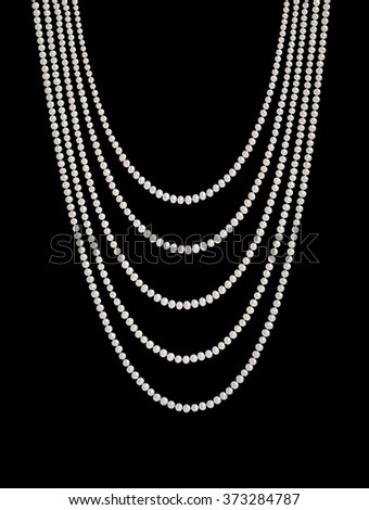 Hanging natural pearl necklace, five rows, isolated on black