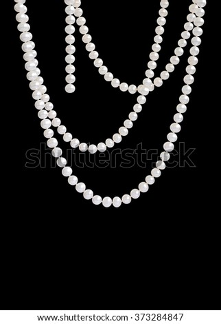 Hanging natural pearl necklace, isolated on black