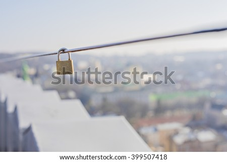 Hanging on the wire lock - stock photo
