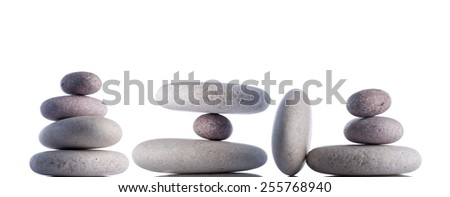 Hanging or floating rocks isolated on white inside studio. - stock photo
