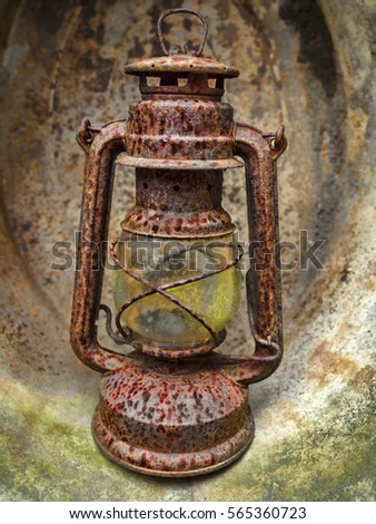 Hanging rusted oil lamp