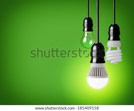 hanging tungsten light bulb, energy saving and LED bulb  - stock photo