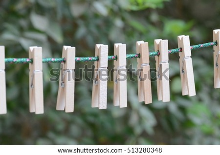Hanging wooden clips.