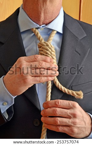 Hangman adjusting a noose rope like tie. - stock photo