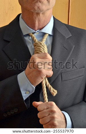 Hangman adjusting a noose rope like tie. - stock photo