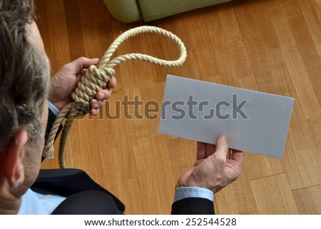 Hangman holding a white chart and letter message. - stock photo