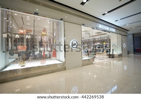 Hangzhou,CHINA - JUN. 24, 2016: interior of Michael Kors store. Michael Kors Holdings is a fashion company established in 1981 by American designer Michael Kors