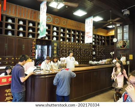 HANGZHOU, CHINA - MAY 22: Visitors visit traditional chinese pharmacy store on May 22, 2014 in Hangzhou, China. It was made a UNESCO World Heritage Site in 2011.