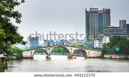 HANGZHOU, CHINA - SEPTEMBER 2013: southern side of Gongchen arch stone bridge over The Grand Canal, daytime view from west bank