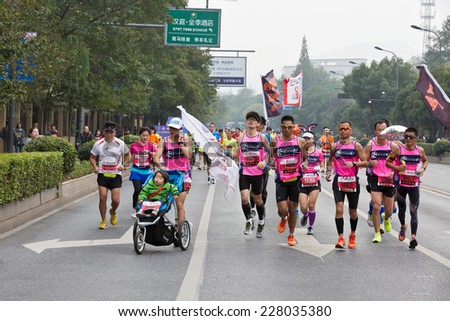 Hangzhou - November 2: international marathon,Chinese Athletes in the running ,  on November 2, 2014 in hangzhou, China. Hangzhou marathon is one of the most important game in China.