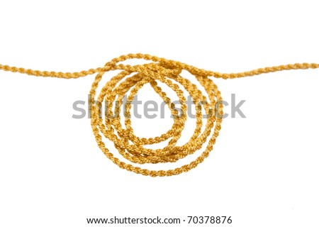 Hank of a gold cord on a white background - stock photo