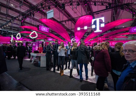 HANNOVER, GERMANY - MARCH 14, 2016: Booth of Deutsche Telekom company at CeBIT information technology trade show in Hannover, Germany on March 14, 2016. - stock photo