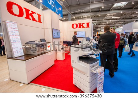 HANNOVER, GERMANY - MARCH 15, 2016: Booth of OKI company at CeBIT information technology trade show in Hannover, Germany on March 15, 2016. - stock photo