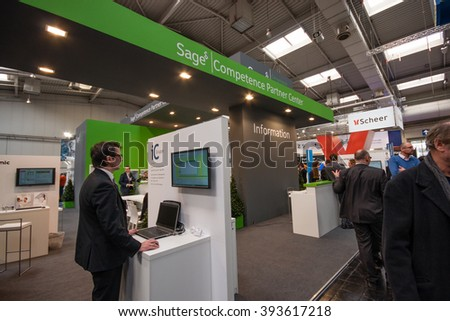 HANNOVER, GERMANY - MARCH 14, 2016: Booth of Sage company at CeBIT information technology trade show in Hannover, Germany on March 14, 2016. - stock photo