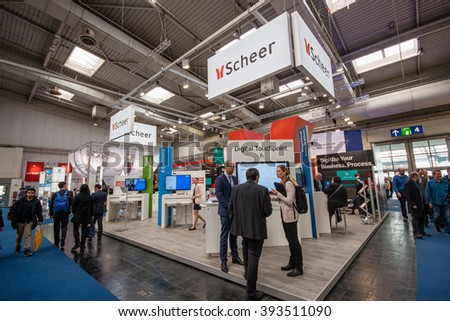 HANNOVER, GERMANY - MARCH 14, 2016: Booth of Scheer company at CeBIT information technology trade show in Hannover, Germany on March 14, 2016. - stock photo