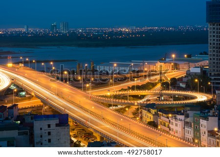 Hanoi cityscape. Aerial view of enter way to Vinh Tuy bridge at twilight