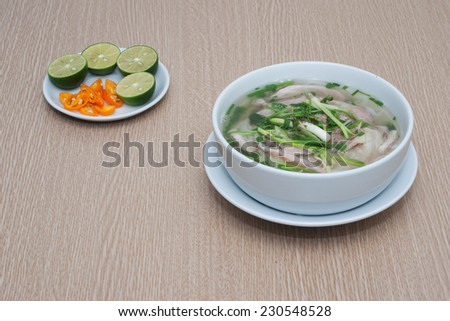 Hanoi Noodle (Pho Hanoi) Pho is used as a breakfast. It made from rice, beef or chicken. - stock photo