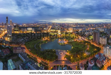 Hanoi skyline cityscape at twilight period. Cau Giay park, west of Hanoi - stock photo