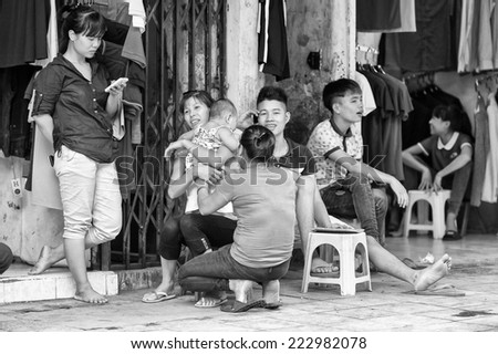 HANOI, VIETMAN - SEP 19, 2014: Unidentified Vietnamese people in the street in Hanoi, Vietnam. 86% of Vietnamese people belong to the Viet ethnic group