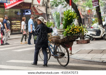 Hanoi, vietnam, Apr 23 2016: typical street vendors in Hanoi's Oldquarter, Vietnam. They sell food,fruits, handicraft, to flower, etc...