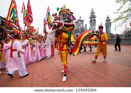 HANOI, VIETNAM-APRIL 14: A group of unidentified people perform dragon dance during Tet Lunar New Year celebrations on April 14, 2013 in Hanoi, Vietnam. This is a traditional cultural activity. - stock photo