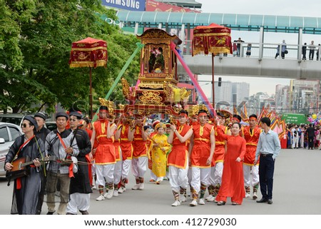 Hanoi, Vietnam: April 22, 2016: Parade on street  in Kim Lien Temple Festival - Parade characterized traditional Buddhist ceremonies in Vietnam.