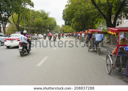 Hanoi, Vietnam - April 13, 2014: Traffic in Dinh Tien Hoang str, Hanoi, Vietnam