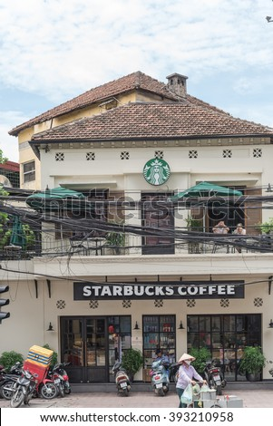 HANOI,VIETNAM-AUG 15,2015:Front view of Starbucks coffee shop in Hanoi, near Vincom shopping mall. The shop opened in Hanoi in July 2014. Starbuck is an American global coffee company and coffeehouse.