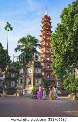 Hanoi, Vietnam - Aug 23, 2015: Yard panoramic view of Tran Quoc temple with women wearing traditional dress Ao Dai visiting the temple. Tran Quoc is the oldest temple in Hanoi