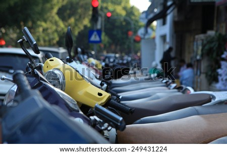 Hanoi, Vietnam - Dec 20, 2014: Motorcycles of many brands parking on a street side of Hanoi capital. Motorcycle is the most popular vehicle in Vietnam. - stock photo