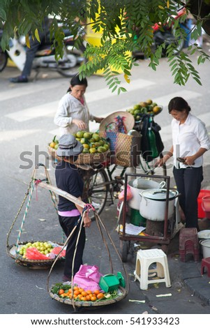 Hanoi VIetnam December 21 2016 Life in Vietnam- Hanoi,Vietnam Street vendors in Hanoi's Old Quarter. Street vendors sell a lot of things, fruits, flowers, personal items, etc..