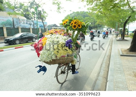 Hanoi, Vietnam - December 13,, 2015: Street vendors. They sell everything from flower, fruits, handicraft goods, bamboo and rattan goods to food. This is a specific tradition in Hanoi old quarter.
