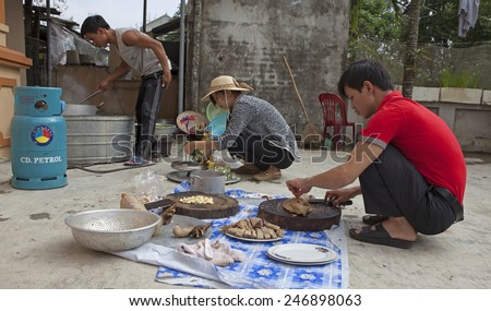Hanoi, Vietnam - Jan 25, 2015: Asian people preparing a traditional meal on special occasion such as lunar (Chinese) new year.