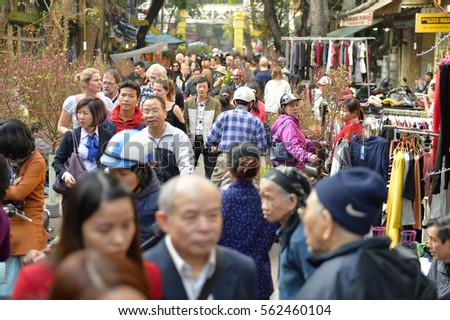 Hanoi, Vietnam - Jan 23,2017: Hanoi's people go to shop for Tet's flower market items served for Tet. The market is open until the last day of the old year according to the lunar calendar.