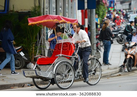 Hanoi, Vietnam - Jan 9th, 2016: Cyclo drivers preparing to pick up passenger by lining up on row at an old street. Cyclo is one of the most favorite vehicles for tourist when come to Vietnam's cities.