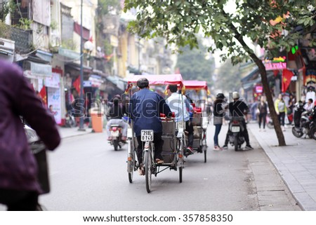 hanoi,vietnam, jan 3, 2016: tourists visit the Hanoi' Old Quater by cyclo. Cyclo is transportation favorite for visiting hanoi