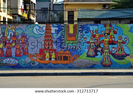 HANOI, VIETNAM. January15, 2015 : The eye in Vietnam mythology made from ceramic decorated on the wall  that builded for the Millennial Anniversary of Hanoi  in Hanoi, Vietnam