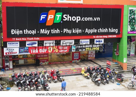 HANOI, VIETNAM - JUL 12, 2014: Front view of a mobile phone store of FPT Telecom in Hanoi capital. FPT is one of the biggest technology groups in Vietnam.