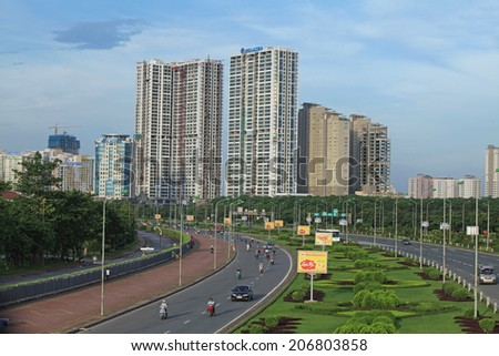 HANOI, VIETNAM - JUL 13, 2014: View from above of a highway in a suburb area of Hanoi capital with many vehicles traveling. Hanoi is on the way of modernization.