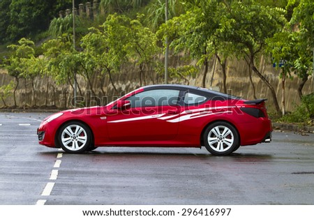 Hanoi, Vietnam - July 4, 2015: Hyundai Genesis Coupe car on test drive road in Vietnam.