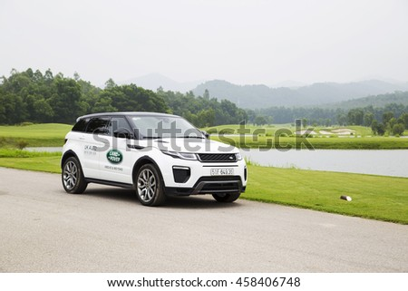 Hanoi, Vietnam - July 13, 2016: Range Rover (Land Rover) Evoque 2016 car on the test road in golf area in Vietnam.